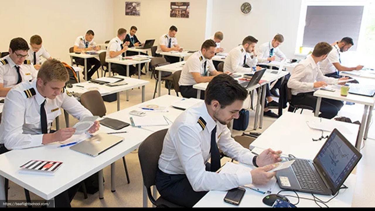 Photograph of a group of uniformed airline pilots in a classroom